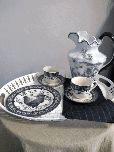 White tray set with black and white dishes, and black and white tea towels.