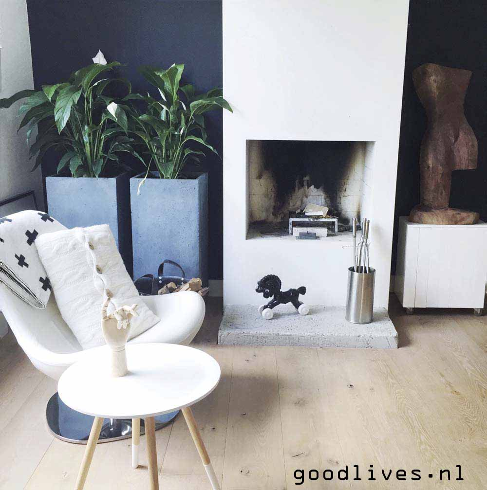 Part of our living room with fireplace and light colored accessories