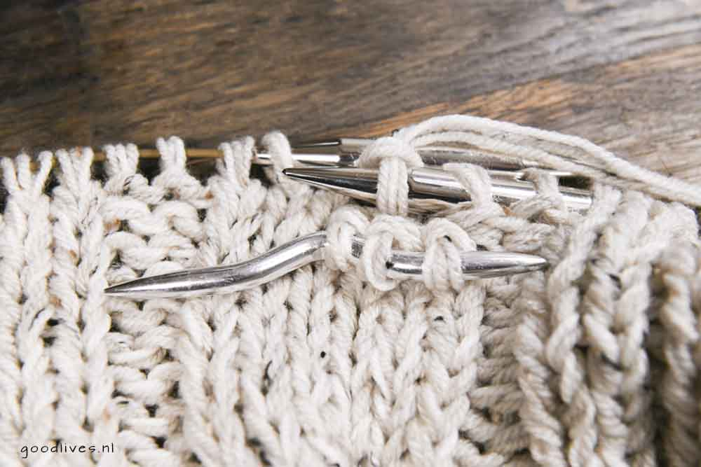Knitting cables, stitches on a cable needle in front of your work