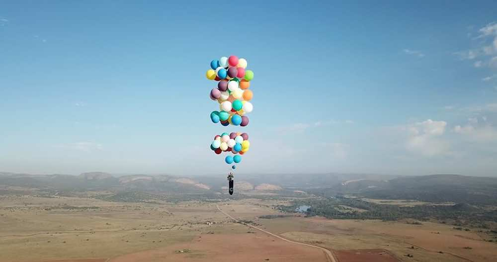 chair with balloons kitchen slipcovers guy uses 100 to fly miles in a lawn the funniest navigation system
