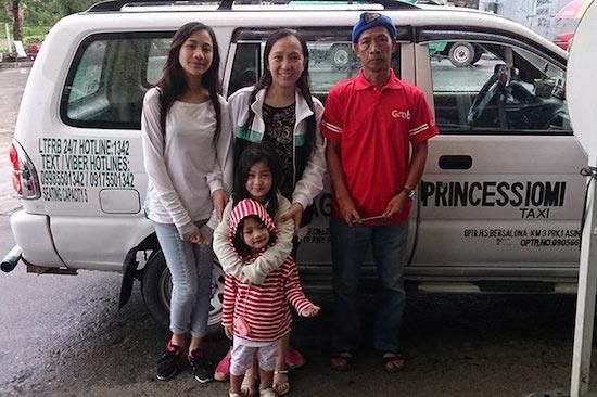 Raymundo Bersalona with some of his passengers