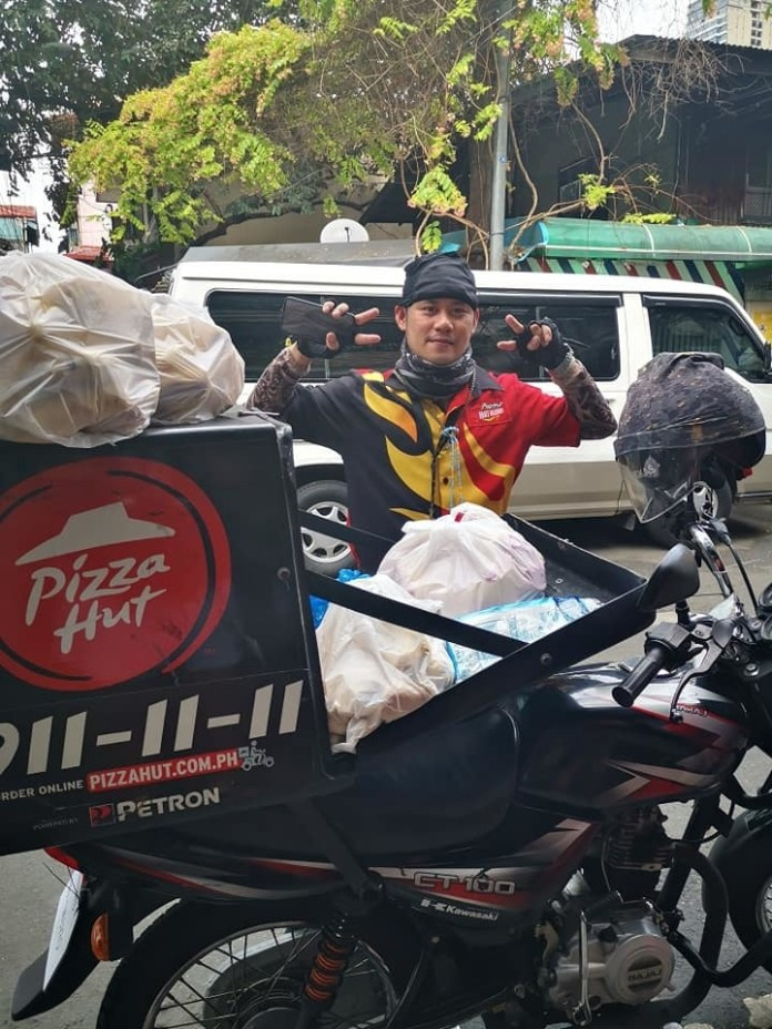 Pizza delivery rider Raymund Papellero