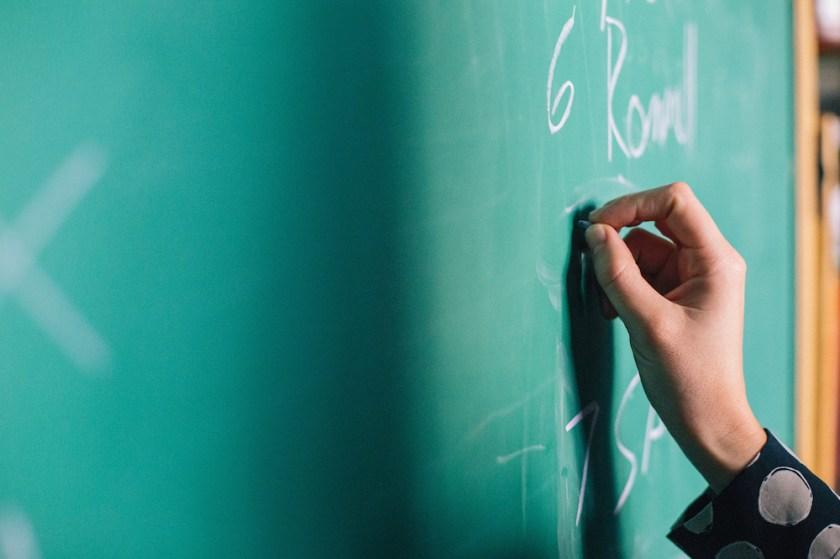 Writing on chalkboard