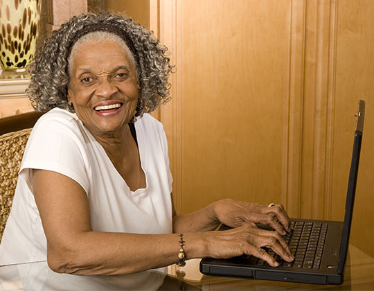 Good Shepherd Woman On Computer - Good Shepherd Fairview Home