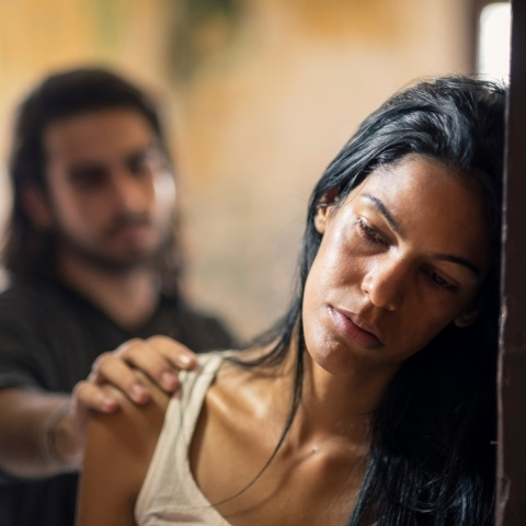 Image result for abuse victim with abuser watching behind her