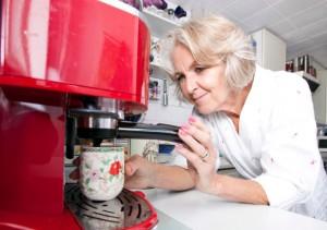 senior woman making coffee
