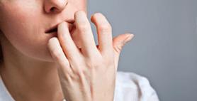 Person biting nails