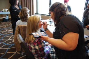 Model Gaylyn Waltz having her makeup done by a future professional from Paul Mitchell the School