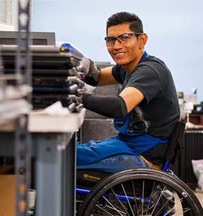 Person with disability at work with Goodwill Light Manufacturing program
