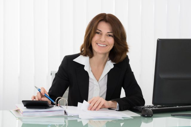 Finance Executive Recuiter Working at Desk In Office