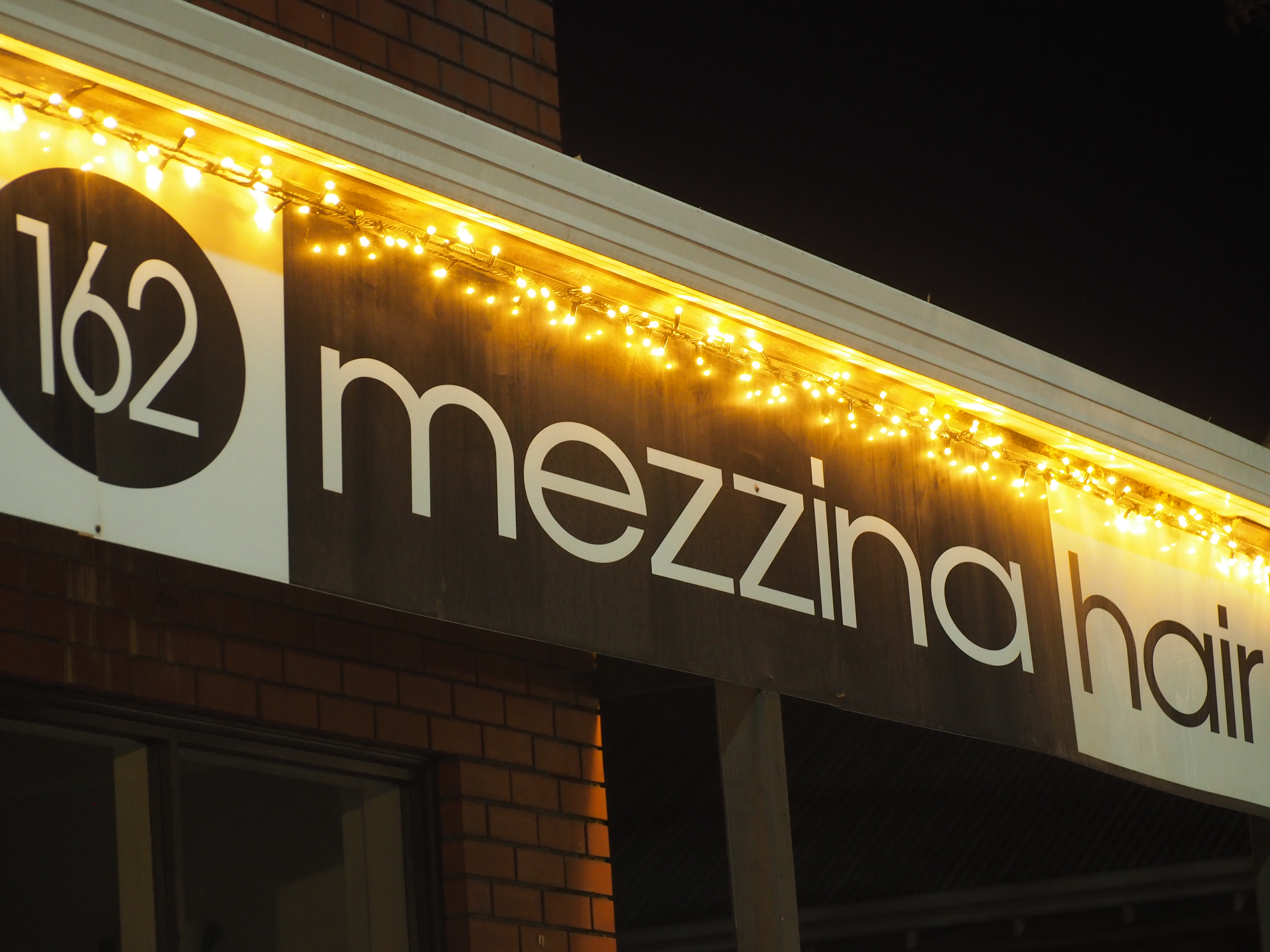 Lights on Mezzina Hair building