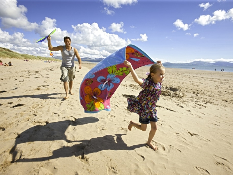 Flying a kite on the beach