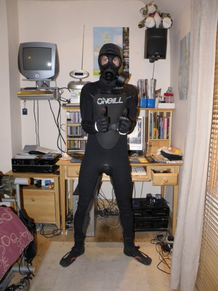 Wetsuit, gas mask and chastity