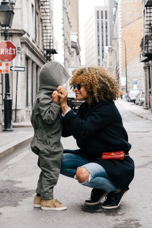mom and son on street
