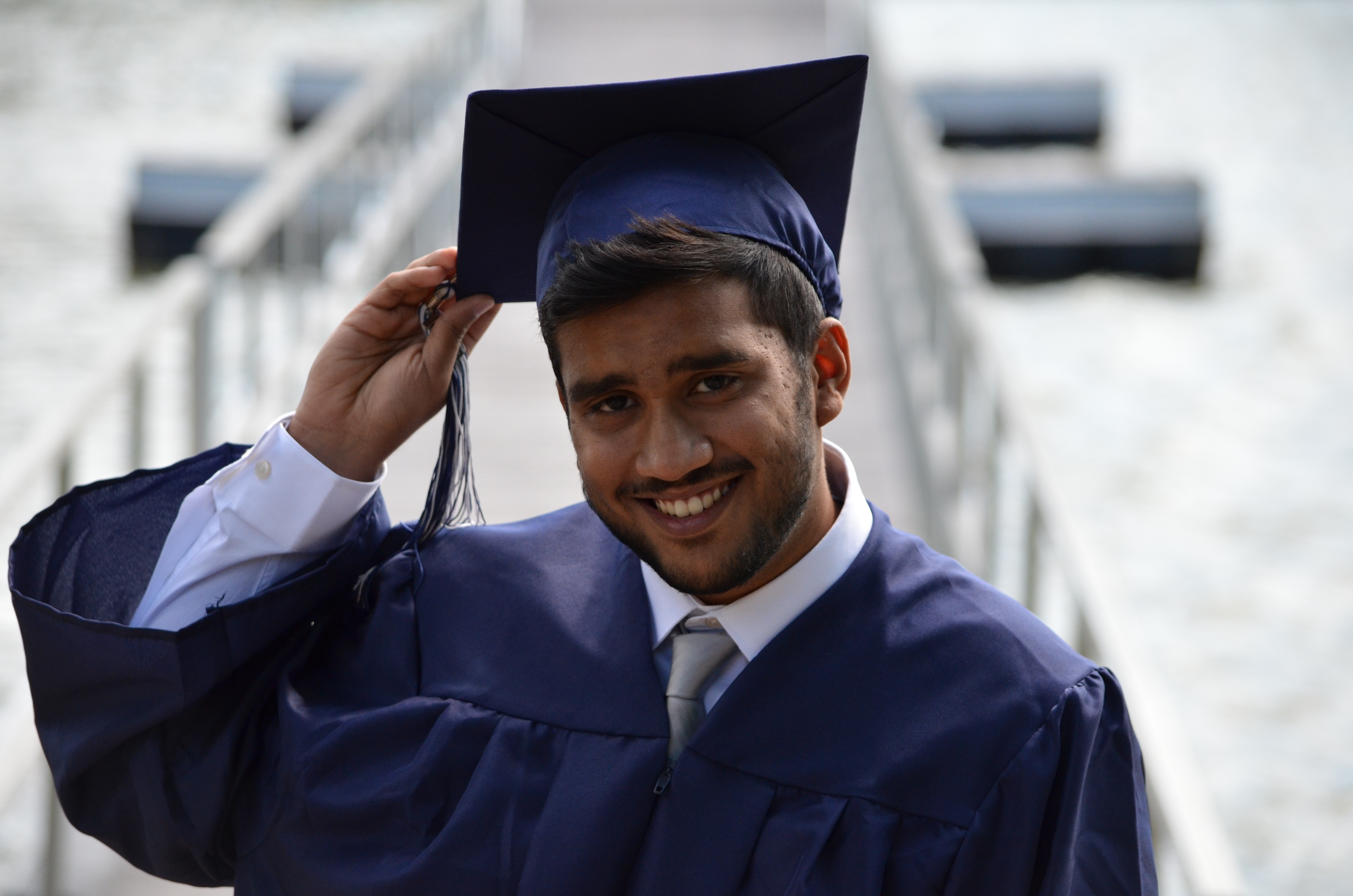College student in graduation robes