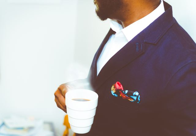 business man in suit with coffee