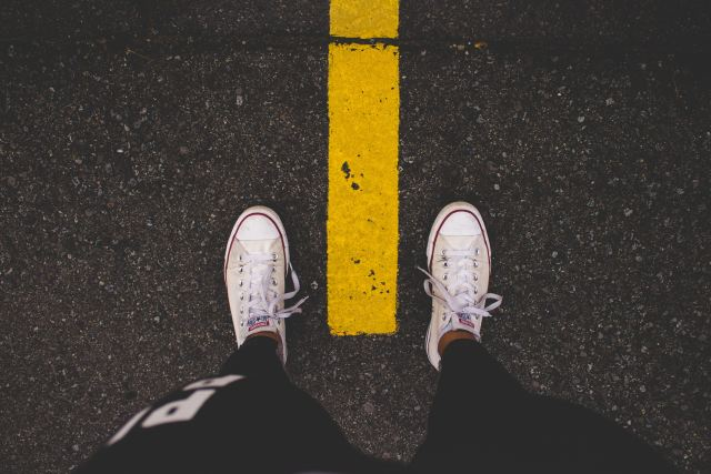 Standing over yellow line in road
