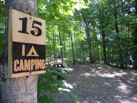 Fun campsite signs and campsite 15 at Gordon's Park on Manitoulin Island