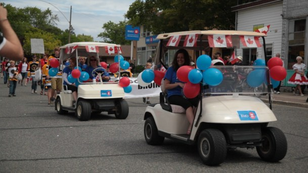 """""""Decorated Golf Carts travel down Gore Bay's main street"""""""