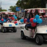"""Decorated Golf Carts travel down Gore Bay's main street"""