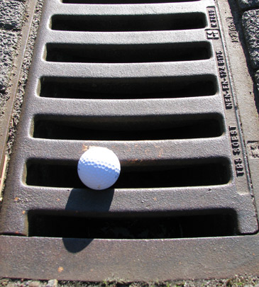 Golf ball in the gutter - Beneficial Tips To Improve Your Golf Match