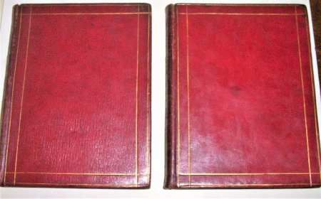 Bound in full straight-grain red morocco, front and back covers of both volumes are ruled in blind in gold