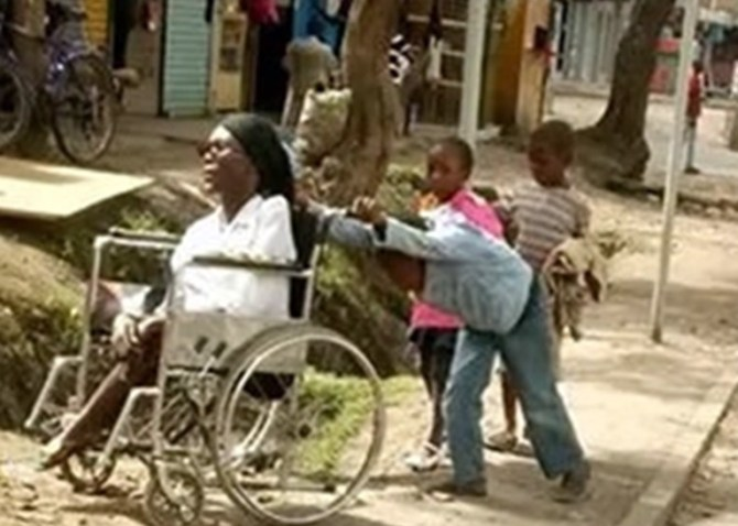 wheel3 - Heartwarming Photos And Story Of 10-year-old Boy Who Wheels His Paralysed Mother To Her Shop Everyday Before Going To School