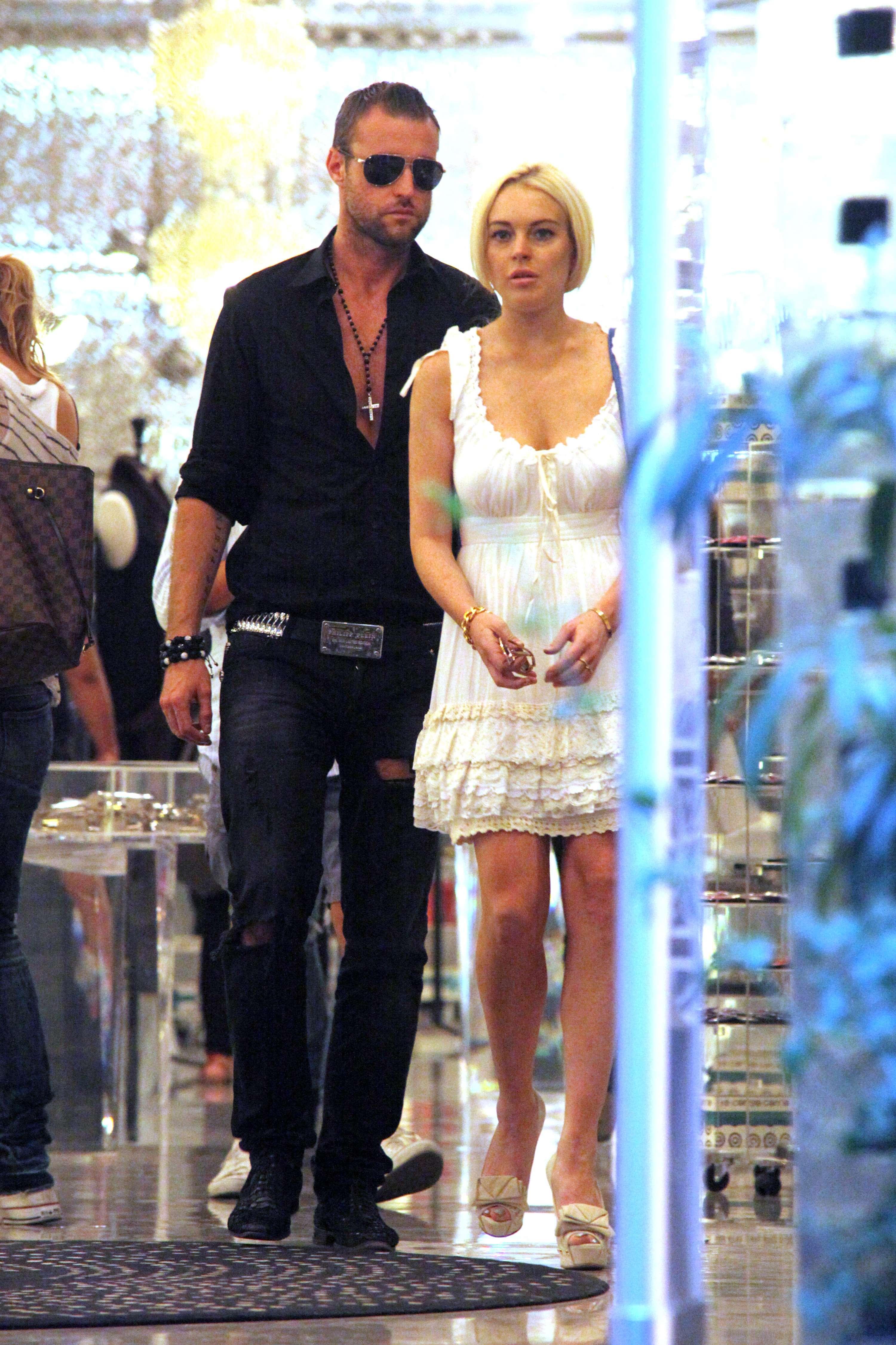 Lindsay Lohan  White Dress Candids in Italy03  GotCeleb