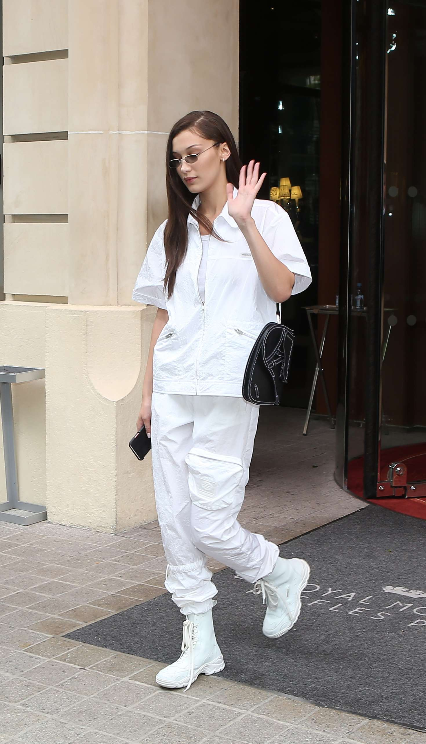 Bella Hadid in White  Leaving Royal Monceau hotel in