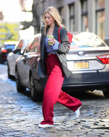 Elsa Hosk – In red oversized pants out in New York City | GotCeleb