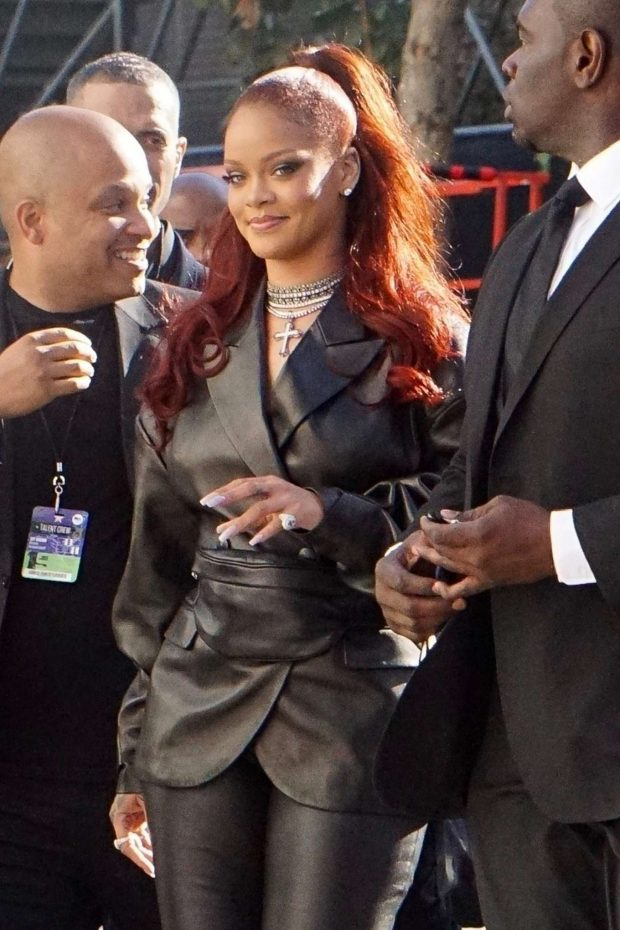 rihanna in leather arrives