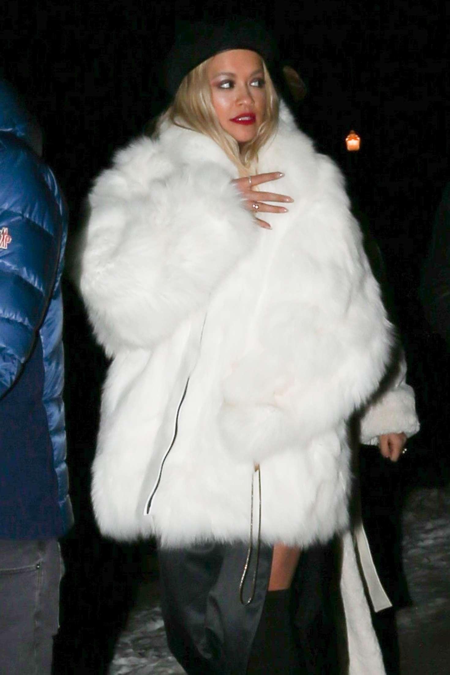 Rita Ora in White Fur Coat  Night out in Aspen
