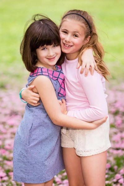 Sisters-hugging-amind-Central-Park-blossoms