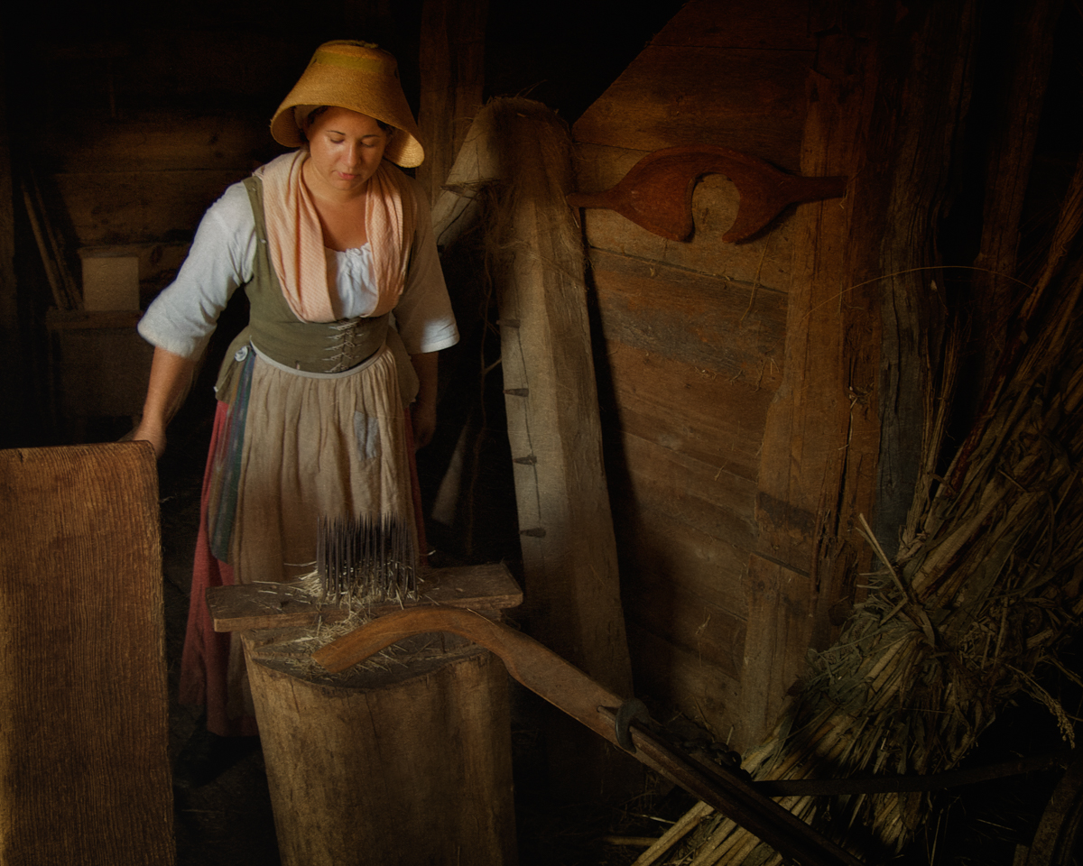 Interpreter Heckling Flax at Philipsburg Manor