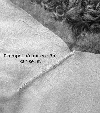 Exempel på söm i lädret på ett lammskinn eller fårskinn.