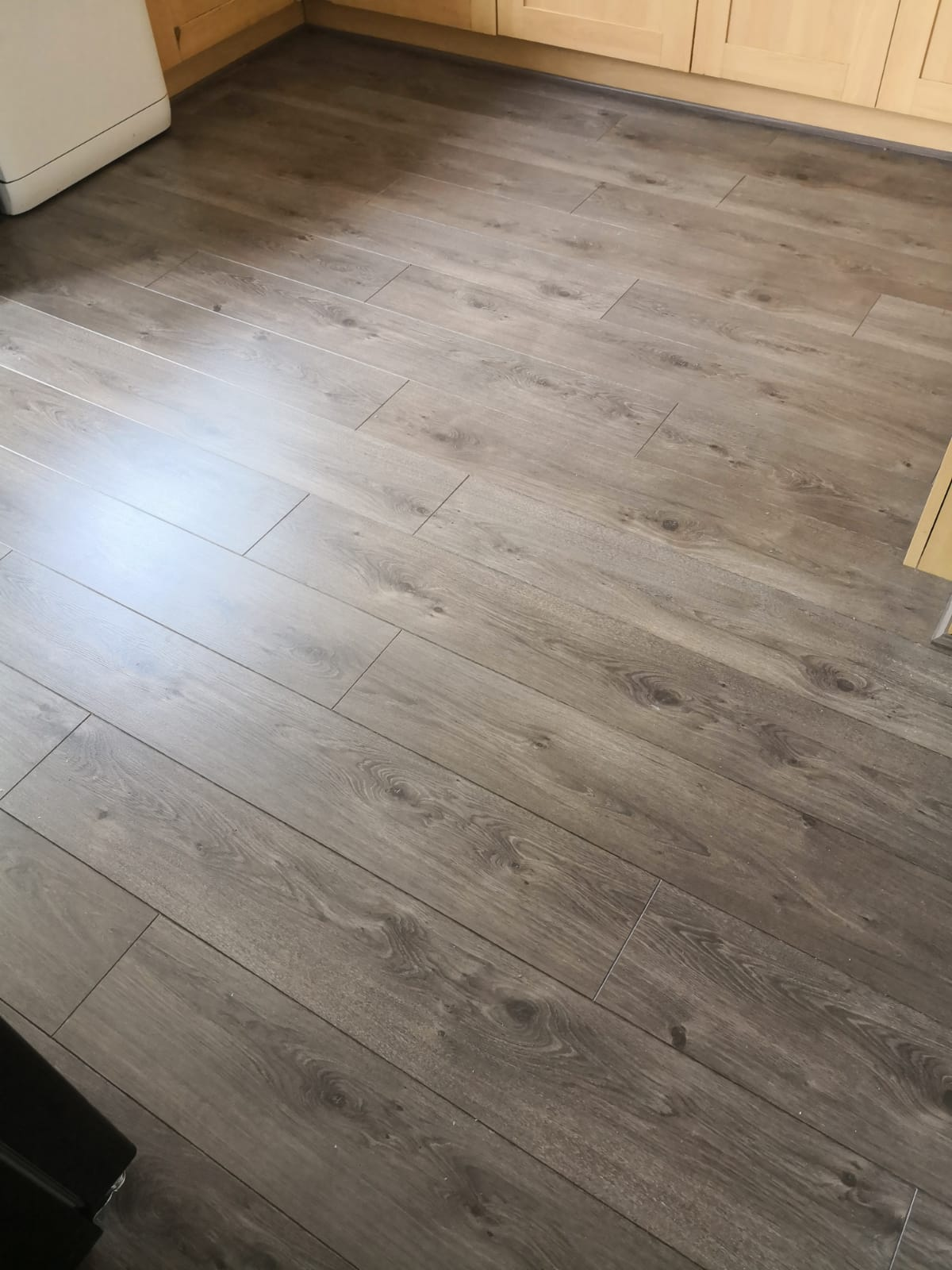 Dining Room and Kitchen Laminate Flooring Installation