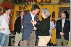 Scott Eckert congratulating Joan Heiny, who just won a Motion Computing Tablet PC