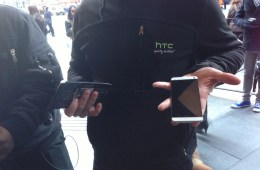 An HTC rep shows off the HTC One at Samsung's Galaxy S4 Launch Event