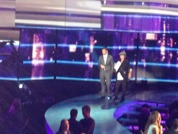 Image captured with iPhone 5 and full digital zoom; American Idol host Ryan Seacrest standing at very far end of stage and in lower right corner is judge and singer Mariah Carey.