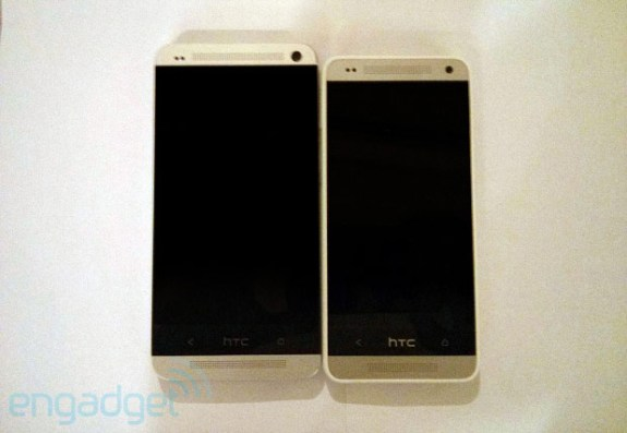 The HTC One Mini on the right, next to the HTC One.
