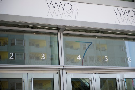 """Banners at Moscone Center in San Francisco show a """"7"""" which points to the unveiling of iOS 7."""