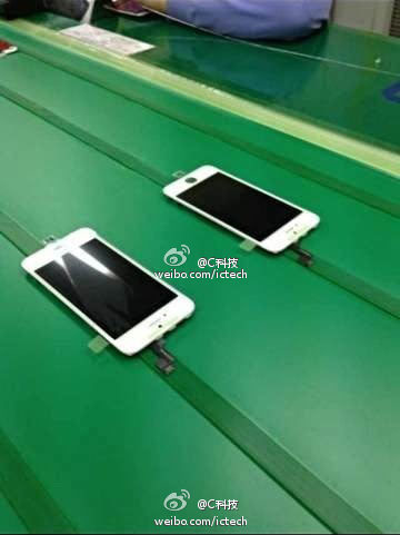 This could be the iPhone 5S front panel on the assembly line.