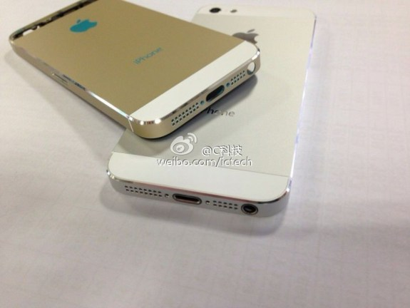 An alleged gold iPhone 5S with a gold chamfered edge and a white glass backplate.