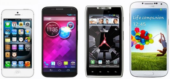 The Moto X stands next to the iPhone 5, Samsung Galaxy S4 and Droid RAZR.
