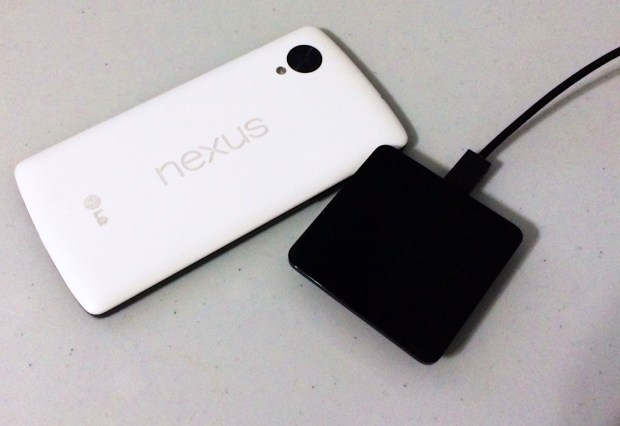 There is still a wire on the Nexus wireless charger, but it is worth the price.