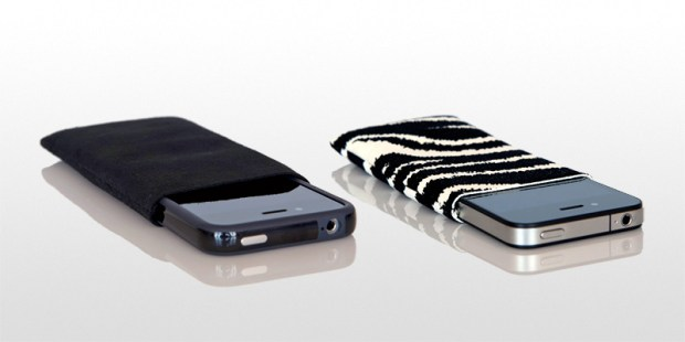 This iPhone 5 cover includes a small pouch for headphones or other items.