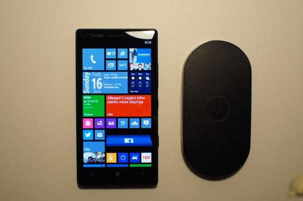 Lumia Icon next to wireless Nokia charging plate.