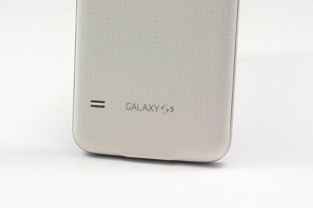 The Galaxy S5 design includes a soft touch dimpled back.