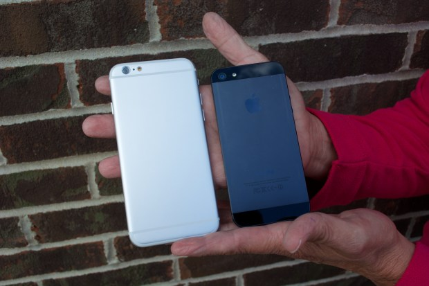 The iPhone 6 and iPhone 5 design differences show in this photo where there is no glass on the new iPhone back.