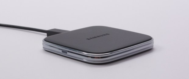 The small charging pad charges quickly, but does not keep charging after the phone hits 100%.